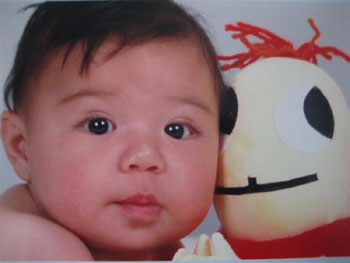 Antonio at six months love his Hug Bug (Bracitos) Valentine!