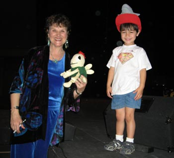 Jake H. tries on Charlotte's Fish Hat on stage at CSUN Theatre in Northridge, California. He also wants to be a 'Pizza' for Halloween