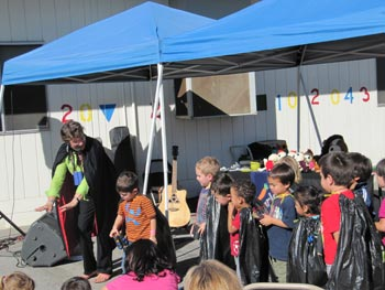 Looking for Dracula with the children at Launch Preschool in LA - notice the hand-made binoculars and capes made from garbage bags.