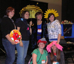 Teachers and Charlotte have fun with her props after the workshop at NAEYC 2008 Conference, Dallas, Texas