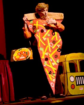 Ronnie Silverstone from BubbleRock performs 'I am a Pizza' on stage with Charlotte at Redondo Beach Performing Arts Center, CA