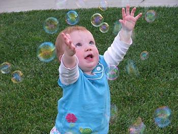 Teagan chasing bubbles