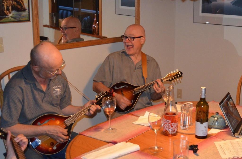 Lee Oliphant - usually the bass player - enjoying his mandolin. And David Jonsson - usually the drummer - enjoying his. [Photo Credit: Linnea Good]