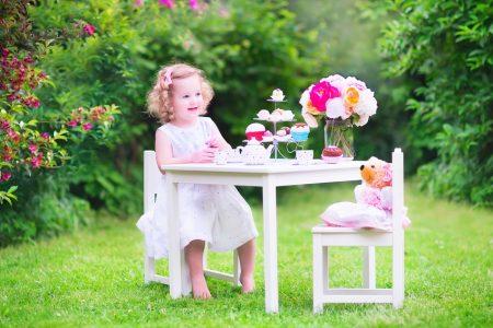 Young girl having a tea party with her teddy bear [Image © famveldman - Fotolia.com]