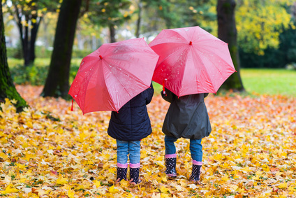 Children walking in the rain [Image © Boggy - Fotolia.com]