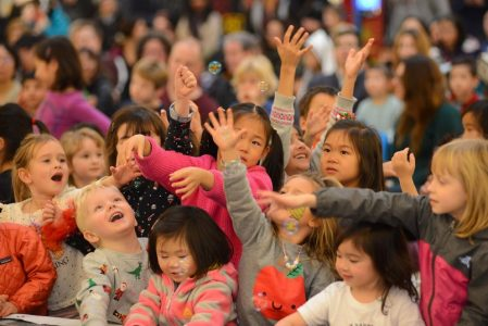 "Children catching bubbles for ""I am a Bubble"" at the Lansdowne Centre's Holiday Concert"